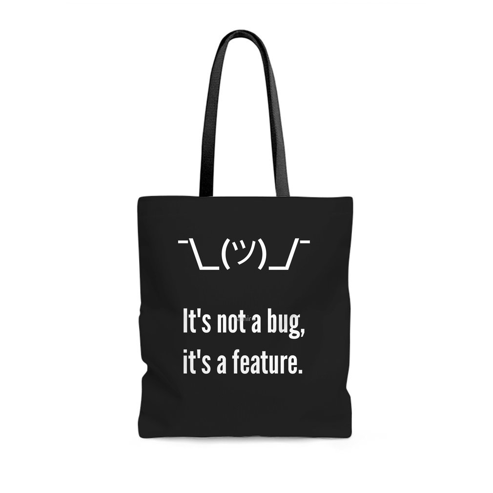 Thumb Shrug It is not a bug, it's a feature. White Text Programmer Excuse Design Tote Bag